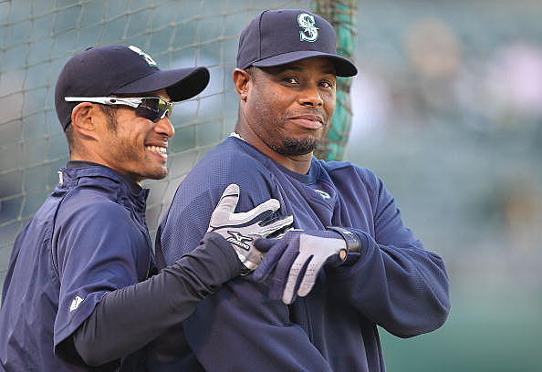 Ichiro Suzuki #51 and Ken Griffey Jr. #24 of the Seattle Mariners look on during batting practice against the Oakland Athletics on Opening Day at the Oakland-Alameda County Coliseum on April 5,