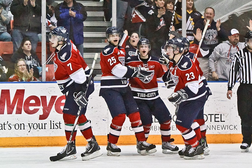 Prokop, Ashton, Schmidt, and Shinnimin Celebrate a goal in the Tri City Americans win over the Spokane Chiefs on March 19th in the Toyota Center.