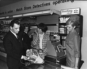 vintage store detective checks for shoplifting