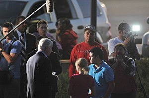 Authorities talk to witnesses outside Aurora theater