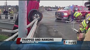 Truck hanging from Oregon overpass