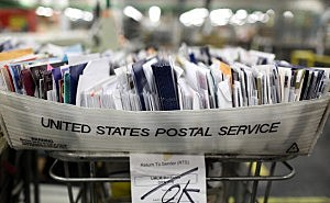 Postal Service delays cutting Saturday mail delivery
