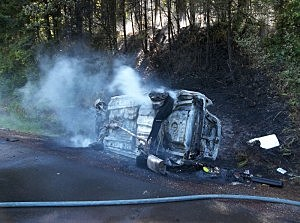 The smoking remains of the car after I-84 crash Monday