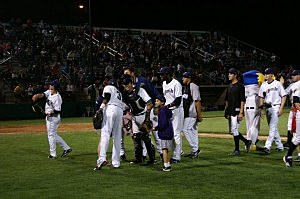 Dust Devils celebrate a victory in 2012 at GESA Stadium