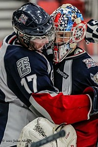 Philip Tot hugs Goalie Eric Comrie after Oct. 6th 2012 win over Lethbridge