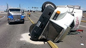 Semi overturns on Columbia Center Blvd.