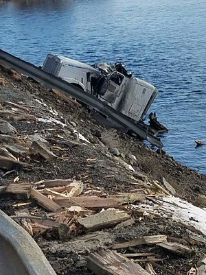 Semi-truck rolled into river, trailer full of apples drifted towards dam (Washington State Patrol)