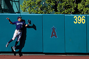 Leonys Martin watches Pujols homer as Mariners blow 7 run lead Sunday (Sean M. Haffe-getty)